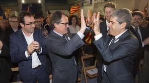 Artur Mas y Francesc Homs, en el mitin de Democràcia i Llibertat en Tarragona.