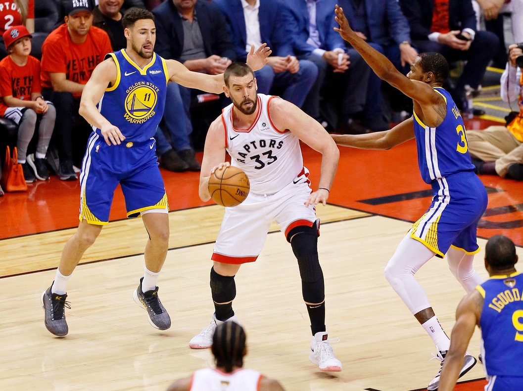 Jun 10, 2019; Toronto, Ontario, CAN; Toronto Raptors center Marc Gasol (33) dribbles the ball while defended by Golden State Warriors guard Klay Thompson (11) and forward Kevin Durant (right) during the first quarter in game five of the 2019 NBA Finals at Scotiabank Arena. Mandatory Credit: John E. Sokolowski-USA TODAY Sports