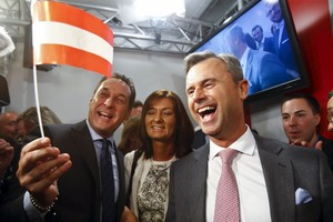 Presidential candidate Norbert Hofer and head of the Austrian Freedom party Heinz-Christian Strache react at the party headquarter in Vienna
