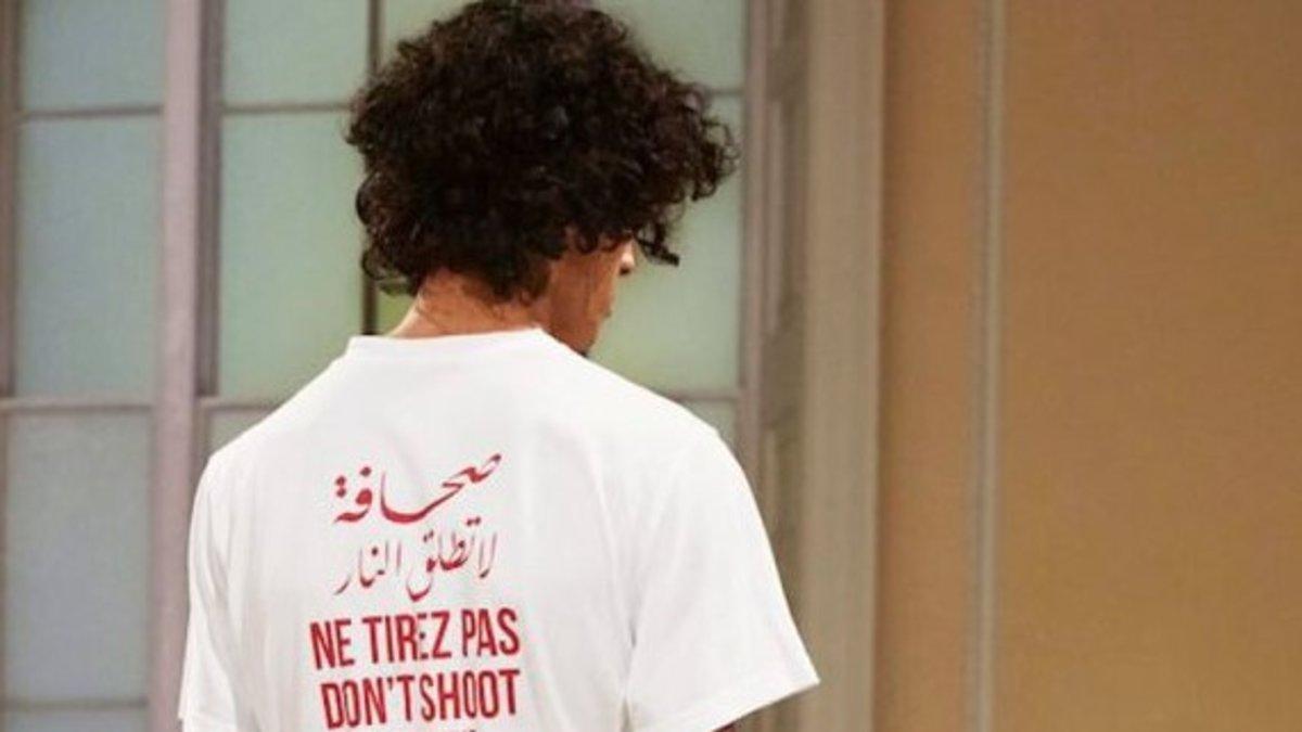 Camiseta con el texto 'No dispare' en varios idiomas