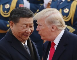 FILE - In this Nov 9 2017 file photo U S President Donald Trump right chats with Chinese President Xi Jinping during a welcome ceremony at the Great Hall of the People in Beijing Following Trump s visit to Beijing China says it s sending a high-level special envoy to North Korea amid an extended chill in relations between the neighbors over Pyongyang s nuclear weapons and missile programs The official Xinhua News Agency said Wednesday Nov 15 2017 that director of the ruling Communist Party s International Liaison Department Song Tao would travel to Pyongyang on Friday to report on the party s national congress held in October AP Photo Andy Wong File
