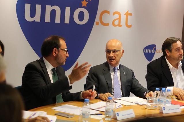 Espadaler (esquerra) parla amb Duran durant la roda de premsa d'aquest dilluns per analitzar les eleccions catalanes.