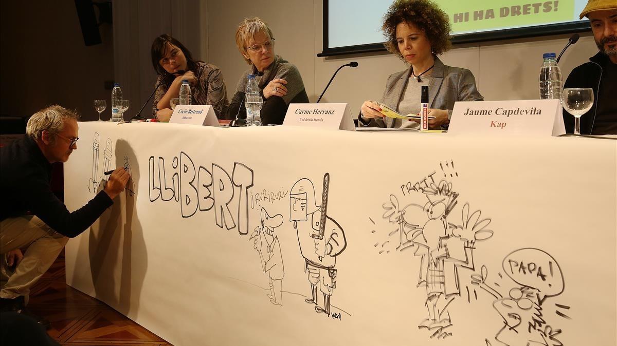 En la presentación del 'Il·legal Times' han participado Jaume Capdevila (KAP) y Cécile Bertrand, en representación de los dibujantes satíricos que han trabajado en el proyecto.