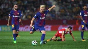 Imagen del último partido en el Barça y el Girona.