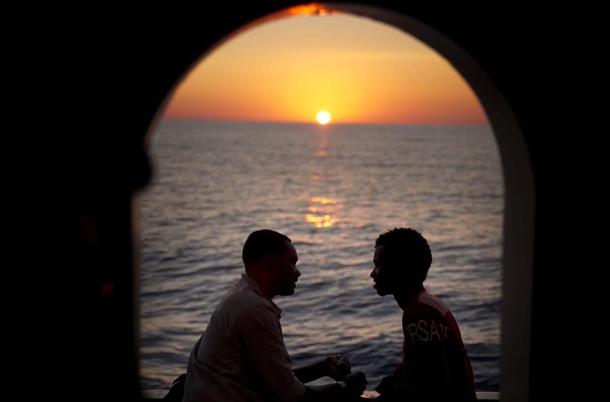 zentauroepp39013238 two men from sudan talk on the deck of the golfo azzurro res170622214629