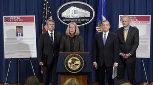 Anuncio en el Departamento de Justicia de la imputación de los espías