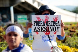 An anti-government protester takes part in a protest against Nicaraguan President Daniel Ortega s government in Managua Nicaragua September 13 2018 The banner reads Out Ortega Killer REUTERS Oswaldo Rivas