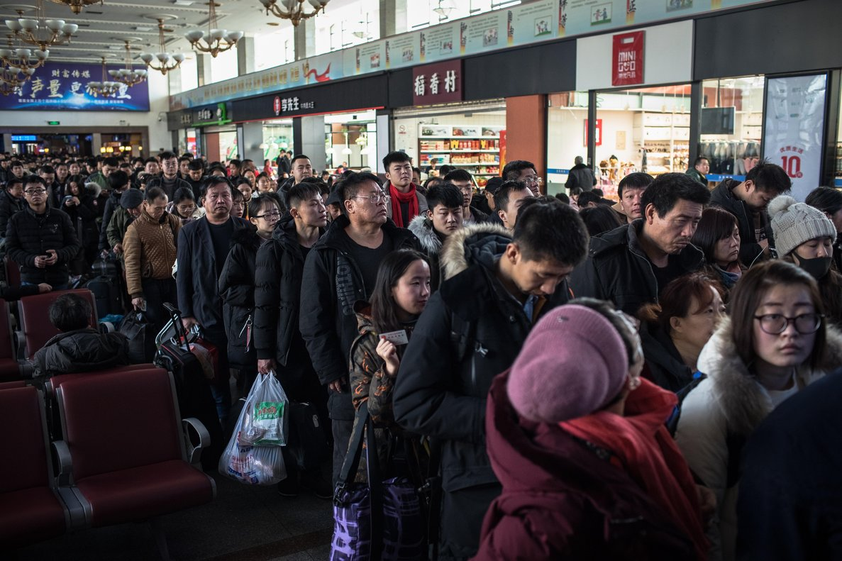 Chinese passengers wait at the Beijing Railway Station to catch their trains home ahead of the Chinese Lunar New Year or Spring Festival in Beijing  EFE EPA ROMAN PILIPEY