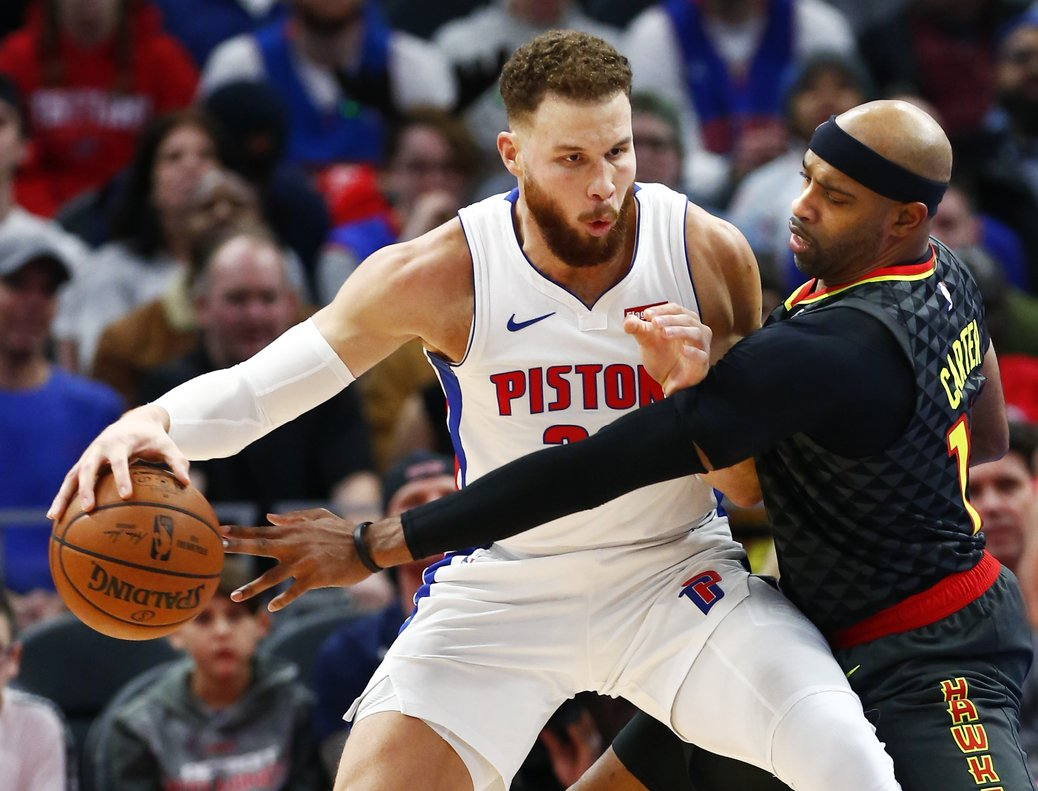 Atlanta Hawks forward Vince Carter  right  tries to steal the ball from Detroit Pistons forward Blake Griffin  left during the second half of an NBA basketball game  in Detroit   AP Photo Duane Burleson