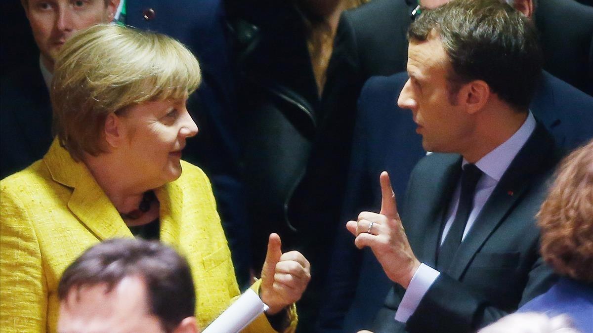 Merkel y Macron, en la cumbre europea en Bruselas.