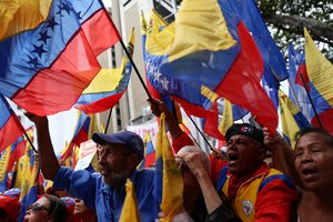 Supporters of Venezuela s President Nicolas Maduro take part in a demonstration to commemorate the Bicentennial of the Boyaca Battle at the National Pantheon in Caracas Venezuela August 7 2019 REUTERS Fausto Torrealba NO RESALES NO ARCHIVE