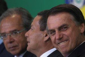 El presidente de BrasilJair Bolsonaroacompanado del vicepresidente de BrasilGeneral Hamilton Mouraoy el ministro de EconomiaPaulo GuedesEFE Joedson Alves