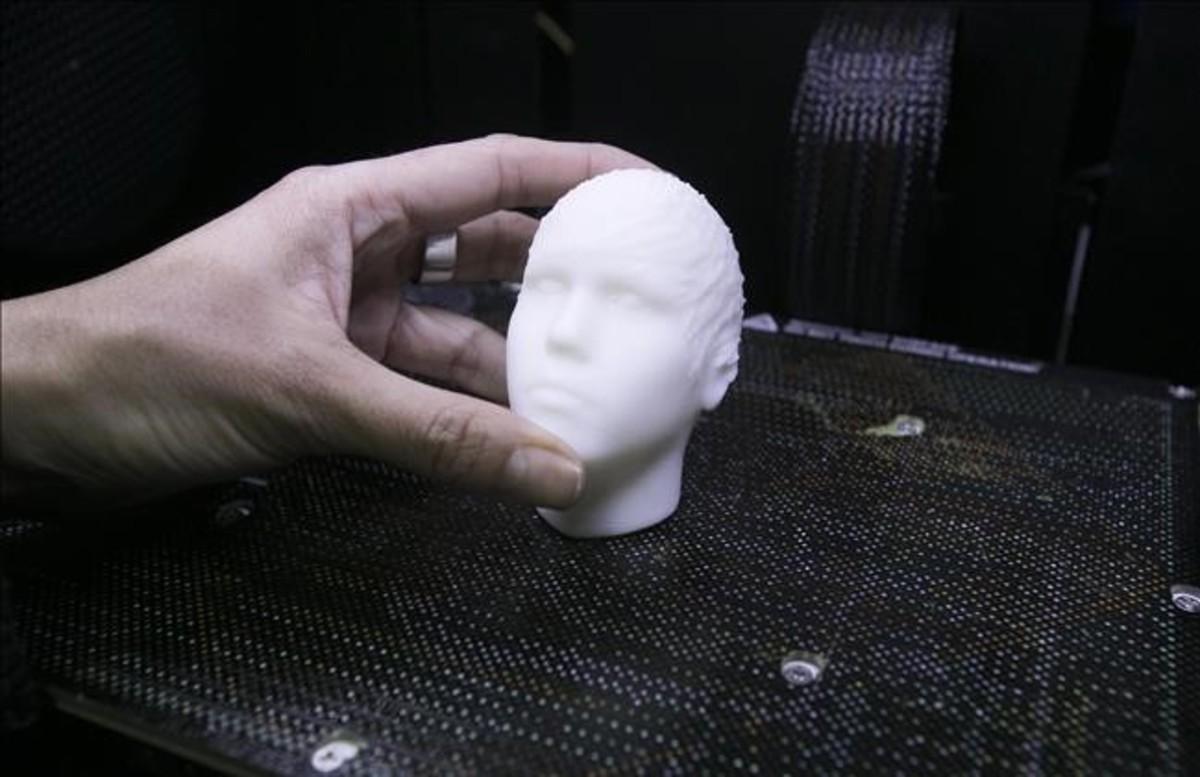 La cabeza multifunción de Justin Bieber, recién salida de la impresora 3D.
