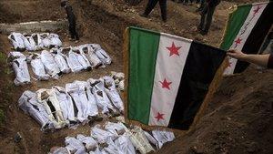 Entierro de civiles ejecutados en Siria en una fotografía del 31 enero del 2013.