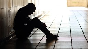 Imagen alegórica de una persona enferma de depresión.
