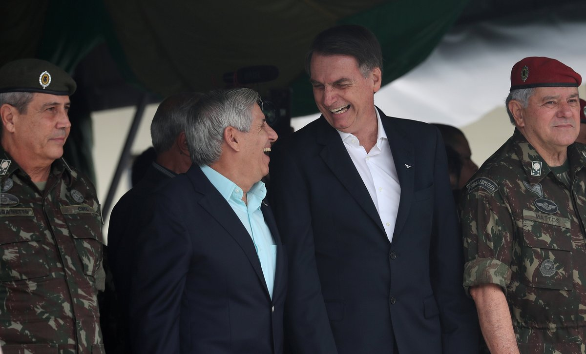 Brazil s President-elect Jair Bolsonaro talks with retired General Augusto Heleno during an event to celebrate the 73rd anniversary of Brazilian Paratrooper Infantry Brigade in Rio de Janeiro. REUTERS Ricardo Moraes