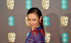 FILE PHOTO: Olga Kurylenko arrives at the British Academy of Film and Television Awards (BAFTA) at the Royal Albert Hall in London, Britain, February 10, 2019. REUTERS/Toby Melville/File Photo