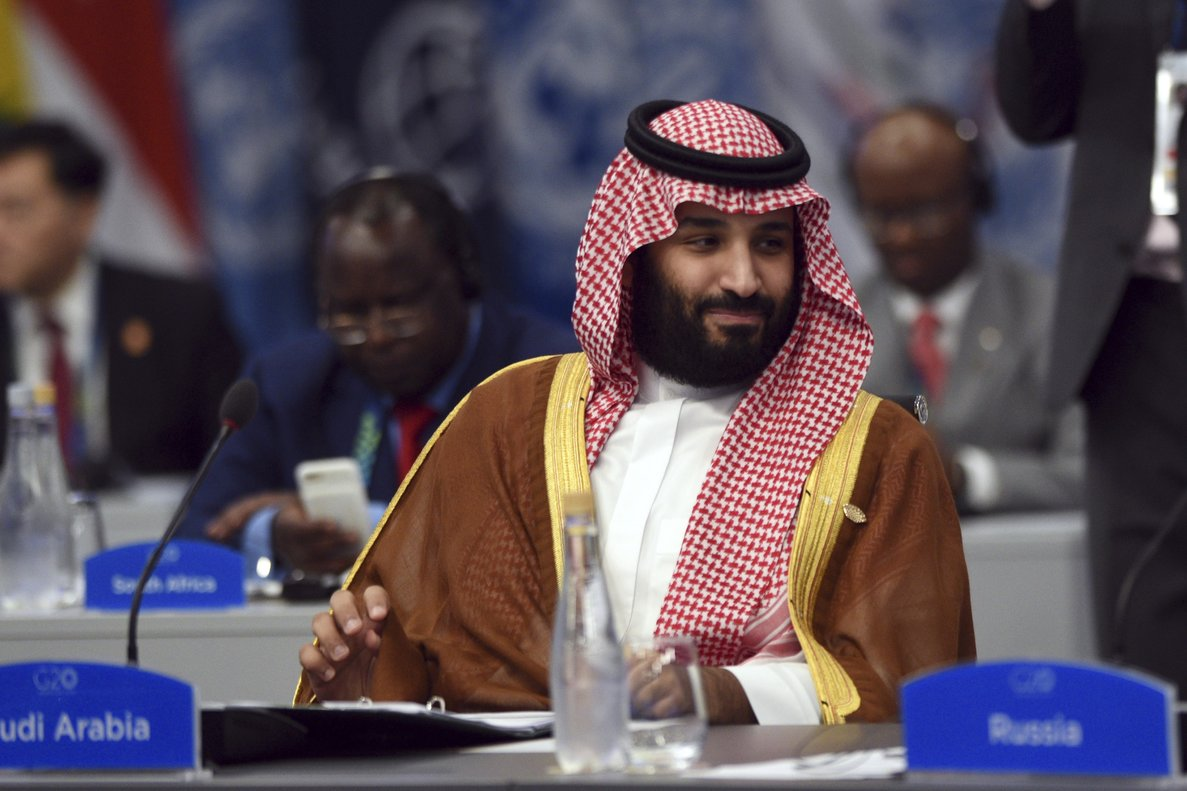 Turkey is seeking the arrest of two former aides to Saudi Crown Prince Mohammed bin Salman who were dismissed amid the fallout from the killing of Washington Post columnist Jamal Khashoggi  G20 Press Office via AP  File