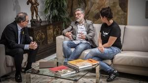 Quim Torra y los diputados de la CUP Carles Riera y Natàlia Sànchez.