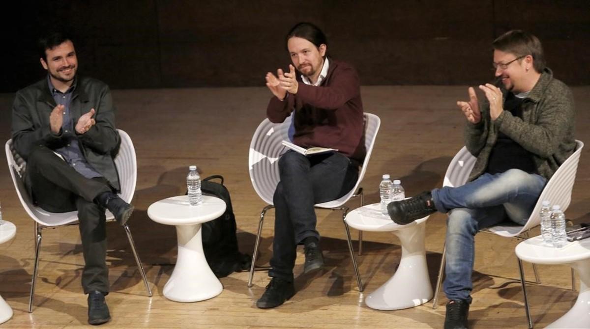 Alberto Garzón, Pablo Iglesias y Xavier Domènech, este viernes, en el debate celebrado en Madrid sobre las confluencias.