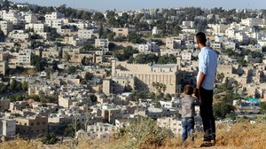 zentauroepp39211764 a general view as palestinians look at the west bank city of170707174004