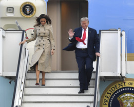 U.S. President Donald Trump and First Lady Melania Trump disembark Air Force One as they arrive at Melsbroek Military airport in Melsbroek, Belgium, Tuesday, July 10, 2018. U.S. President Donald Trump is in Brussels to attend a two-day NATO summit. (AP Photo/Geert Vanden Wijngaert)