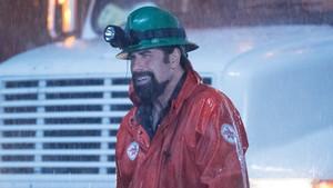 John Travolta, en la película Hombres de élite.