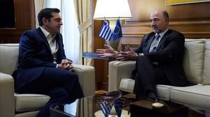 Tsipras y Moscovici., en una reunión en Atenas el mes de febrero pasado.