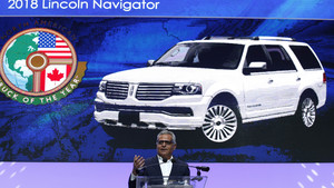 Lincolns Galhotra accepts award at the North American International Auto Show in Detroit