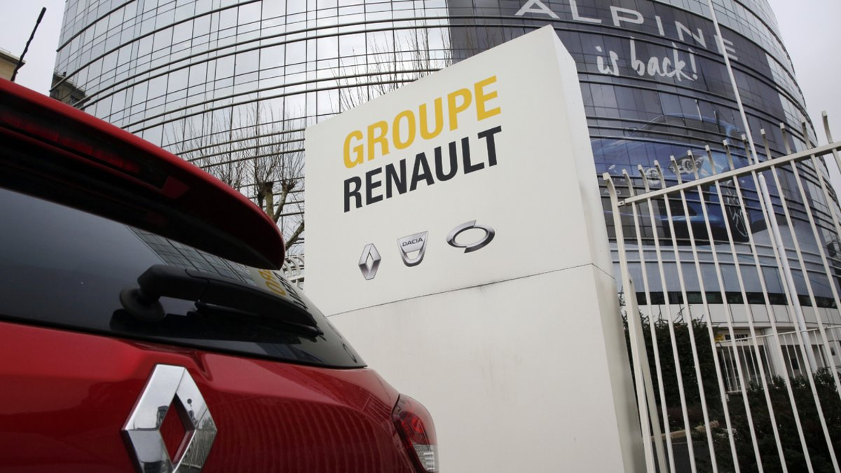 This photo taken on Thursday, Jan. 24, 2019 show a Ranult car parking outside the French carmaker headquarters in Boulogne-Billancourt, outside Paris, France. French carmaker Renault looks set to give its approval to Fiat Chrysler's merger offer. The company's board is meeting Tuesday afternoon at its headquarters to decide on a deal that could reshape the global auto industry. (AP Photo/Christophe Ena)