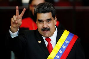 FILE PHOTO Venezuelan President Nicolas Maduro gestures after receiving the presidential sash during the ceremonial swearing-in for his second presidential term at the Supreme Court in Caracas Venezuela Jan 10 2019 REUTERS Carlos Garcia Rawlins File Photo