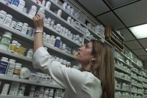 Pharmacist Amy Sidney replaces the antibiotic Cipro on the shelf of her drugstore Saturday, Oct. 13, 2001, in New York. Sidneys pharmacy was overwhelmed by requests to fill prescriptions for the antibiotic after a confirmed case of Anthrax was reported Friday in New York and forced to limit each prescription to a ten day supply. (AP Photo/Beth A. Keiser)