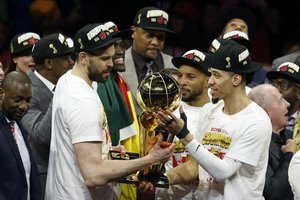 OAKLAND, CALIFORNIA - JUNE 13: Marc Gasol #33 and Danny Green #14 of the Toronto Raptors celebrate with the Larry OBrien Championship Trophy after his team defeated the Golden State Warriors to win Game Six of the 2019 NBA Finals at ORACLE Arena on June 13, 2019 in Oakland, California. NOTE TO USER: User expressly acknowledges and agrees that, by downloading and or using this photograph, User is consenting to the terms and conditions of the Getty Images License Agreement. Lachlan Cunningham/Getty Images/AFP