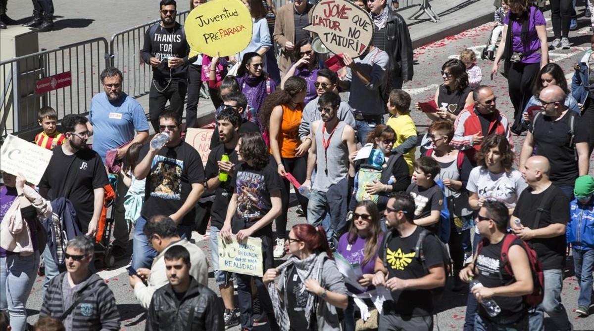 Manifestantes en la marcha del Primero de Mayo en Barcelona.
