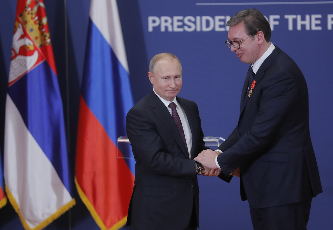 Russian President Vladimir Putin decorates Serbian President Alexandar Vucic with an order of Alexander Nevsky after their meeting in Belgrade  Serbia Maxim Shipenkov Pool via REUTERS