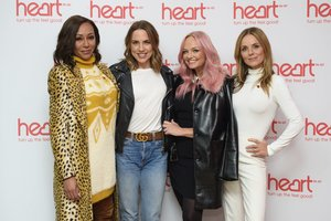 Spice Girls from left  Melanie Brown  Melanie Chisholm  Emma Bunton and Geri Horner  pose for a photo during a live appearance on a radio show at Global Radio in Leicester Square  London. The Spice Girls will reunite for a British stadium tour next summer.  Matt Crossick PA via AP