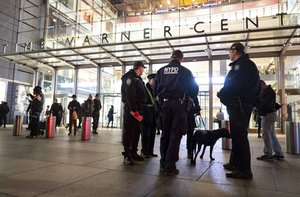 New York City police officers stand by the scene after a report of a possible suspicious package was called in at the Time Warner Center Thursday   in New York  Normal activity resumed at the building shortly after police cleared the scene   AP Photo Craig Ruttle