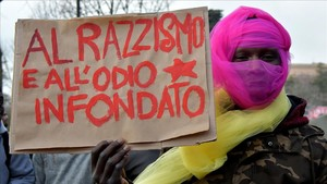 zentauroepp41998832 topshot a protester holds placard reading to racism and u180210185130