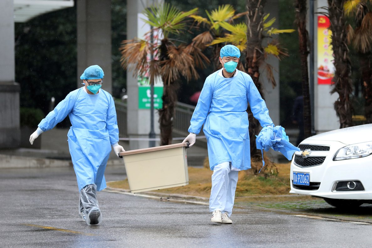 FILE PHOTO: Medical staff carry a box as they walk at the Jinyintan hospital, where the patients with pneumonia caused by the new strain of coronavirus are being treated, in Wuhan, Hubei province, China January 10, 2020. REUTERS/Stringer/File Photo