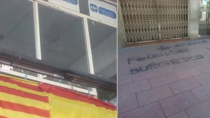 Imagen de una ventana rota y de las pintadas en la sede del PP de Nou Barris.
