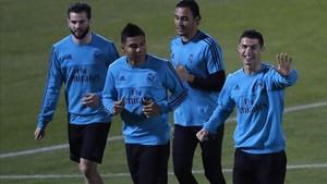 Nacho, Casemiro, Keylor Navas y Cristiano Ronaldo, en el entrenamiento del Madrid este jueves.
