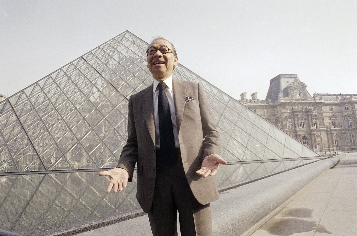 FILE - In this March 29 1989 file photo Chinese-American architect I M Pei laughs while posing for a portrait in front of the Louvre glass pyramid which he designed in the museum s Napoleon Courtyard prior to its inauguration in Paris Pei the globe-trotting architect who revived the Louvre museum in Paris with a giant glass pyramid and captured the spirit of rebellion at the multi-shaped Rock and Roll Hall of Fame has died at age 102 a spokesman confirmed Thursday May 16 2019 AP Photo Pierre Gleizes File