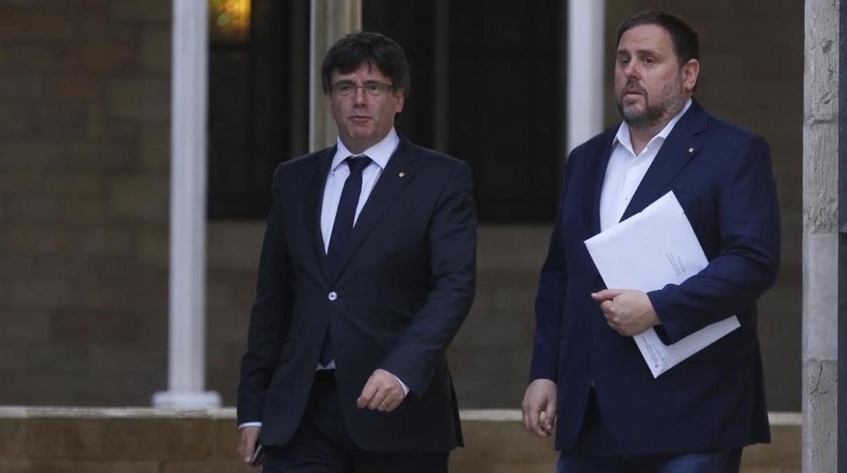 El president, Carles Puigdemont, y el vicepresidente del Govern, Oriol Junqueras.