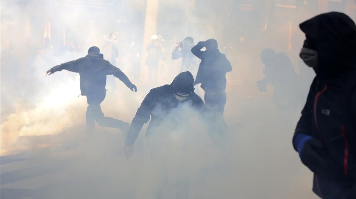monmartinez38257044 youths battle through tear gas grenades during clashes part 170501175053