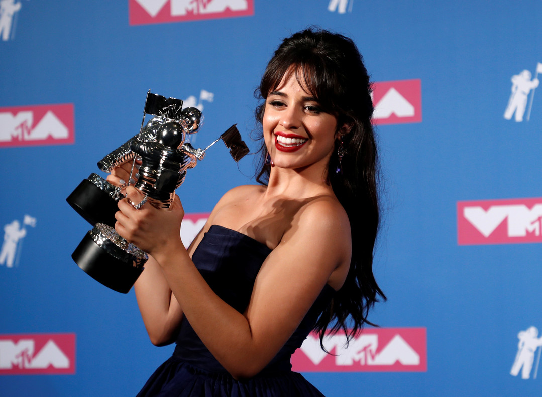 2018 MTV Video Music Awards - Photo Room - Radio City Music Hall, New York, U.S., August 20, 2018. - Camila Cabello poses backstage with her awards for Artist of the Year and Video of the Year for Havana. REUTERS/Carlo Allegri TPX IMAGES OF THE DAY