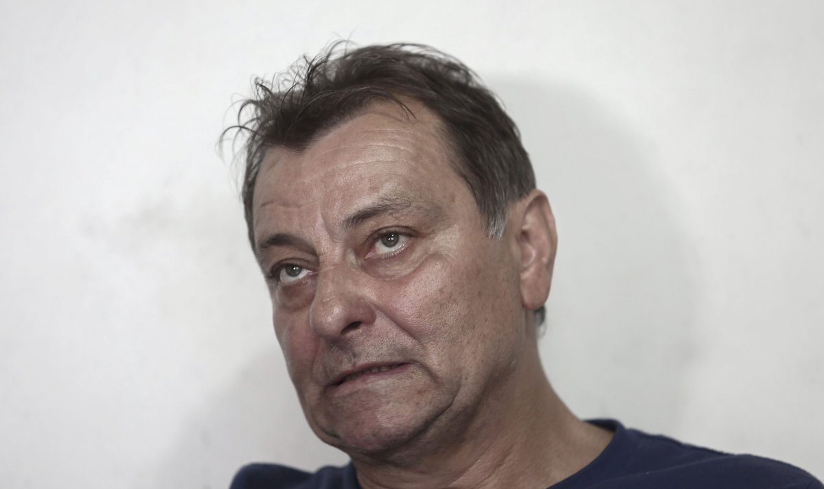 Italian ultra-leftist activist Cesare Battisti gestures during an interview with AFP in CananeiaSao Paulo stateBrazil- A judge of the Brazilian Supreme Court orderedthe arrest in order to extraditeBattistiwanted in Italywhere he was sentenced for four murders he deniesPhoto by Miguel SCHINCARIOLAFP
