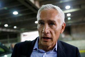 Jorge Ramos anchor of Spanish-language U S television network Univision talks to the media as he prepares to leave the country at the Simon Bolivar international airport in Caracas Venezuela February 26 2019 REUTERS Carlos Garcia Rawlins
