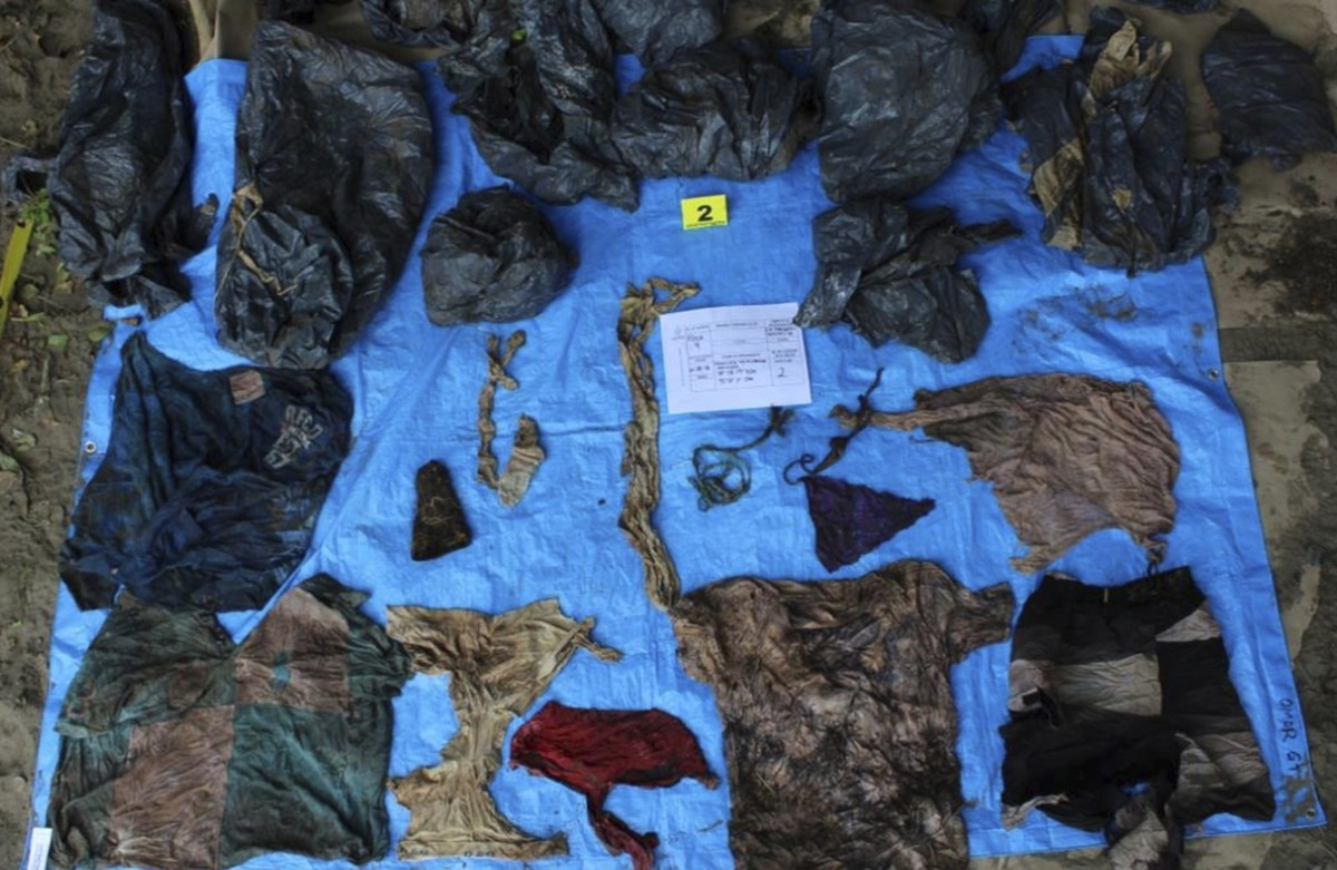 In this undated photo provided by the Veracruz State Prosecutor s Office shows clothing items found at the site of a clandestine burial pit in the Gulf coast state of VeracruzMexicoVeracruz state prosecutor Jorge Winckler said the bodies were buried at least two years ago and did not rule out finding more remainsHe said investigators had found 114 ID cards in the fieldwhich held about 32 burial pitsVeracruz State Prosecutor s Office via AP