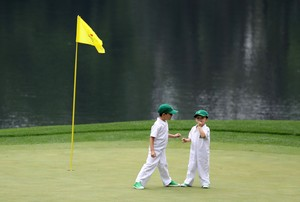 AUGUSTA, GA - APRIL 05: Two children stand on a green during the Par 3 Contest prior to the start of the 2017 Masters Tournament at Augusta National Golf Club on April 5, 2017 in Augusta, Georgia. The Par 3 Contest was later cancelled due to inclement weather. Rob Carr/Getty Images/AFP