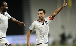 Xavi Hernández no desaprovechó la oportunidad de pasar un rato con sus excompañeros en Doha.